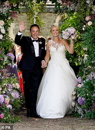 Bride and groom: They looked stunning as they stepped out together