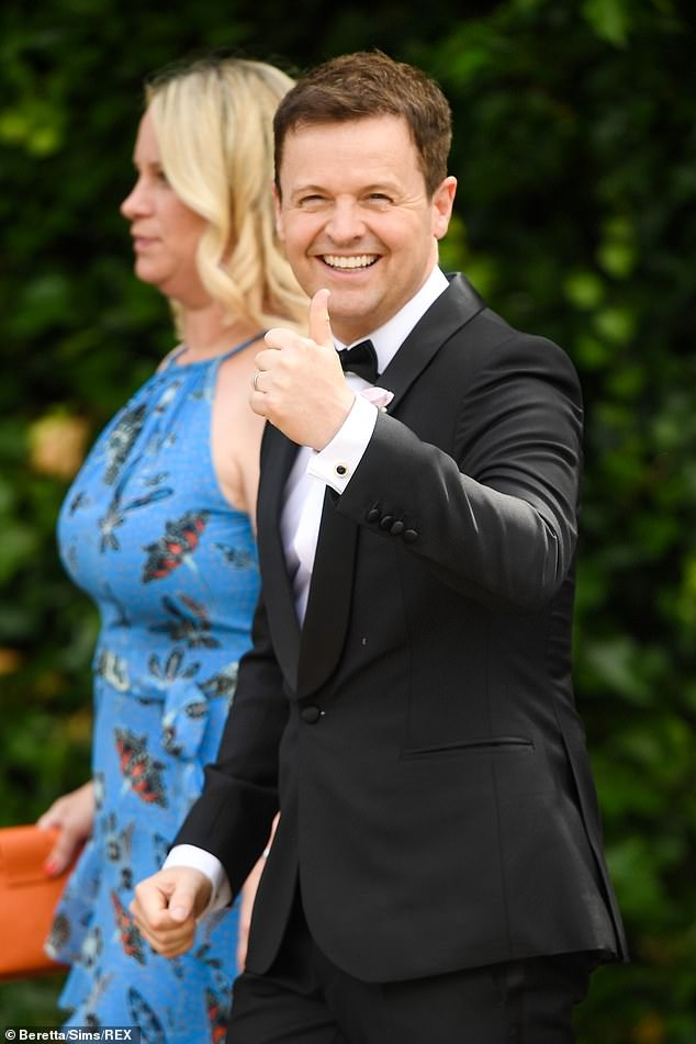 Happy:Ever-suave, Dec sported a pastel pink boutonnière on his left lapel and was spotted giving an enthusiastic thumbs-up to photographers