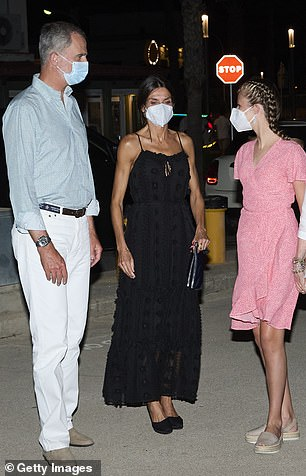 Queen Letizia is pictured leaving the restaurant with Princess Leonor and King Felipe last night