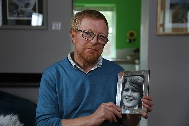 Suzy's brother Richard said 'it would be lovely to find her' and scatter her ashes (Pictured: Richard holding a framed photo of his missing sister)