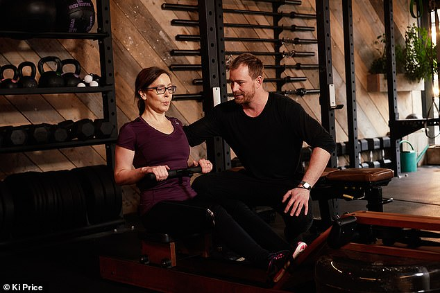 Michal advised Anna to do rowing to improve her posture and strength. Pictured:Anna Maxted with trainer Michael