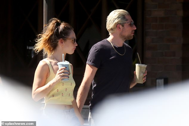 Switching it up: While Lily is back to being brunette, Michael recently dyed his hair blond