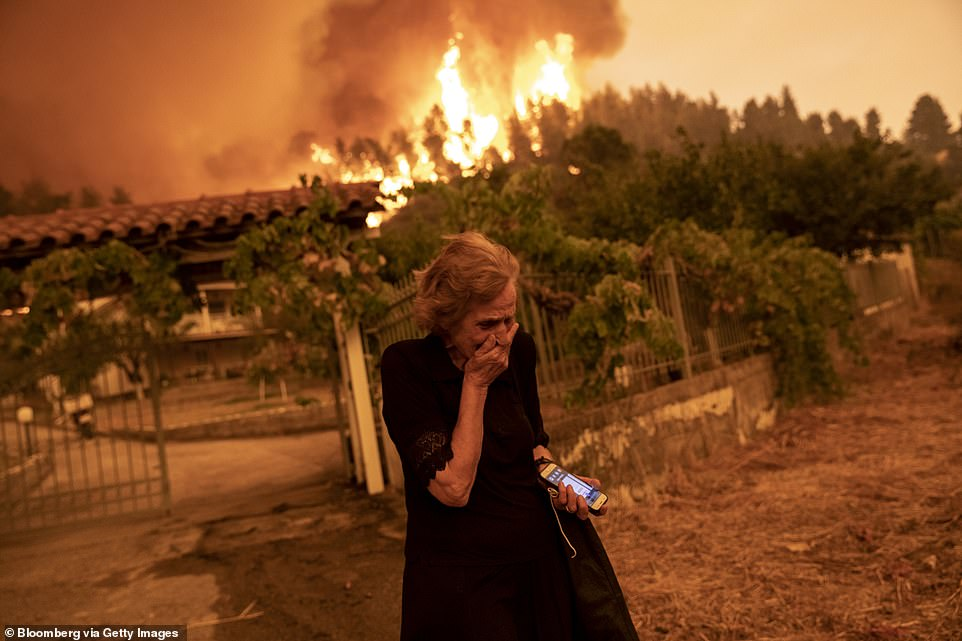 One elderly woman was reduced to tears as her home was engulfed in blazes which were sparked by the country's worst heatwave in 30 years which has dried up forests and turned them into tinder boxes