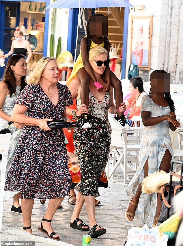 Terrific trio:CharlizeAugust, five, as well as her mother Gerda Jacoba Aletta Maritz in Greece on Monday.