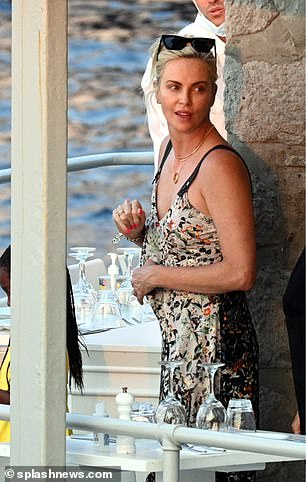 Radiant: Charlize allowed her natural beauty to shine through with minimal makeup