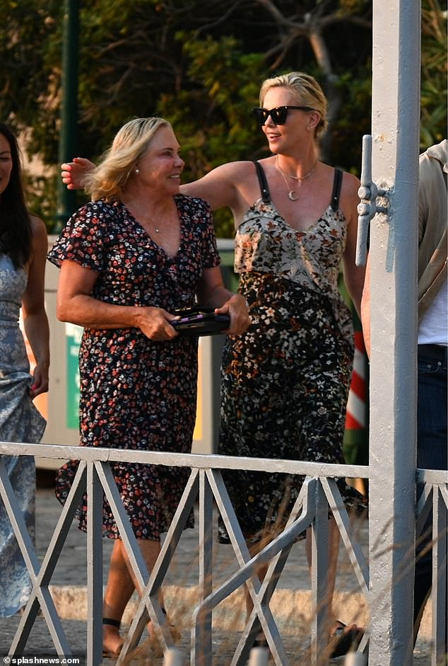 Seeing double: The family resemblance between Charlize and her mother was clear to see, with the ladies looking like blonde bombshells on the outing