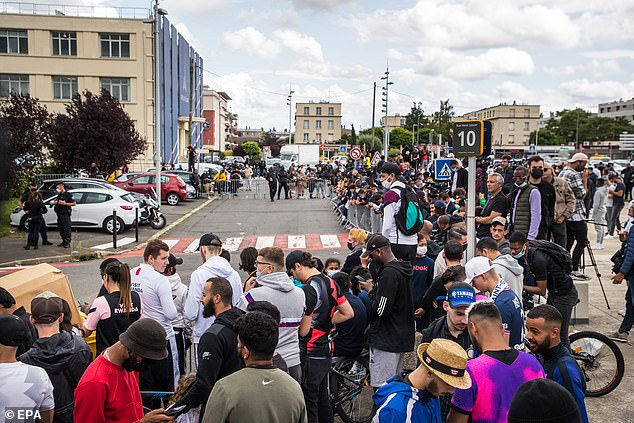 Fans outside Le Bourget Airport in anticipation Messi will arrive there sometime on Monday