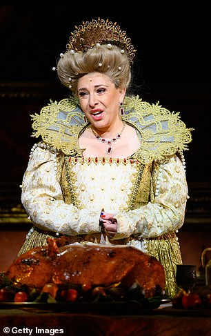 Queen Camilla! Tracy-Ann dons Queen Elizabeth I garb, complete with an elaborate ruff in one scene