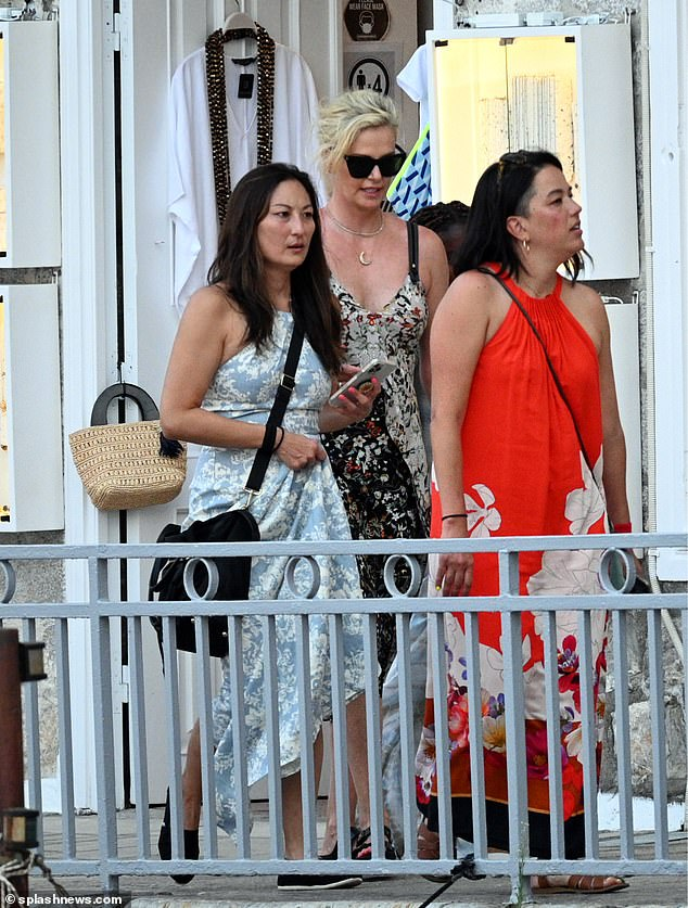 Sun, fun and friends: Charlize seemed in great spirits as she joined her pals for a day out on the island