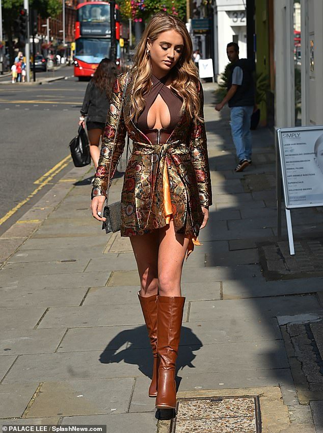 Chic: The influencer showcased her ample assets in the floral peep-front ensemble as she hit up the Simply Clinics Kings road launch that afternoon