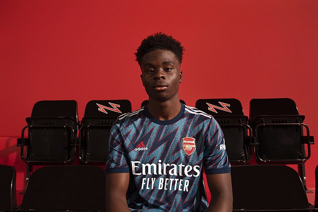 England winger Bukayo Saka was another Arsenal star to show off their new shirt