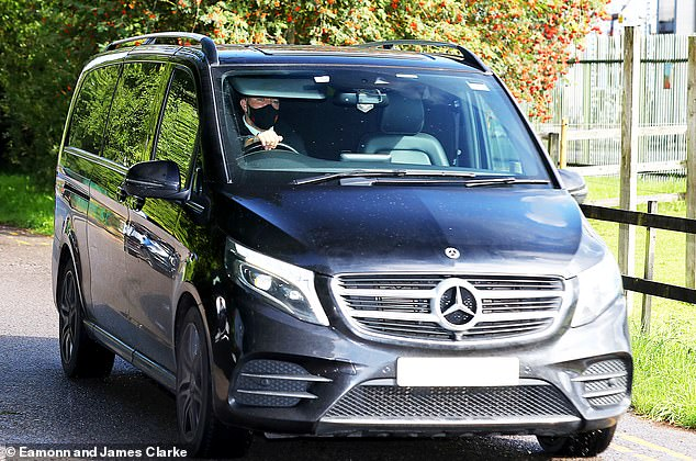 Raphael Varane was ushered into Man United's training ground in the back of a black Mercedes