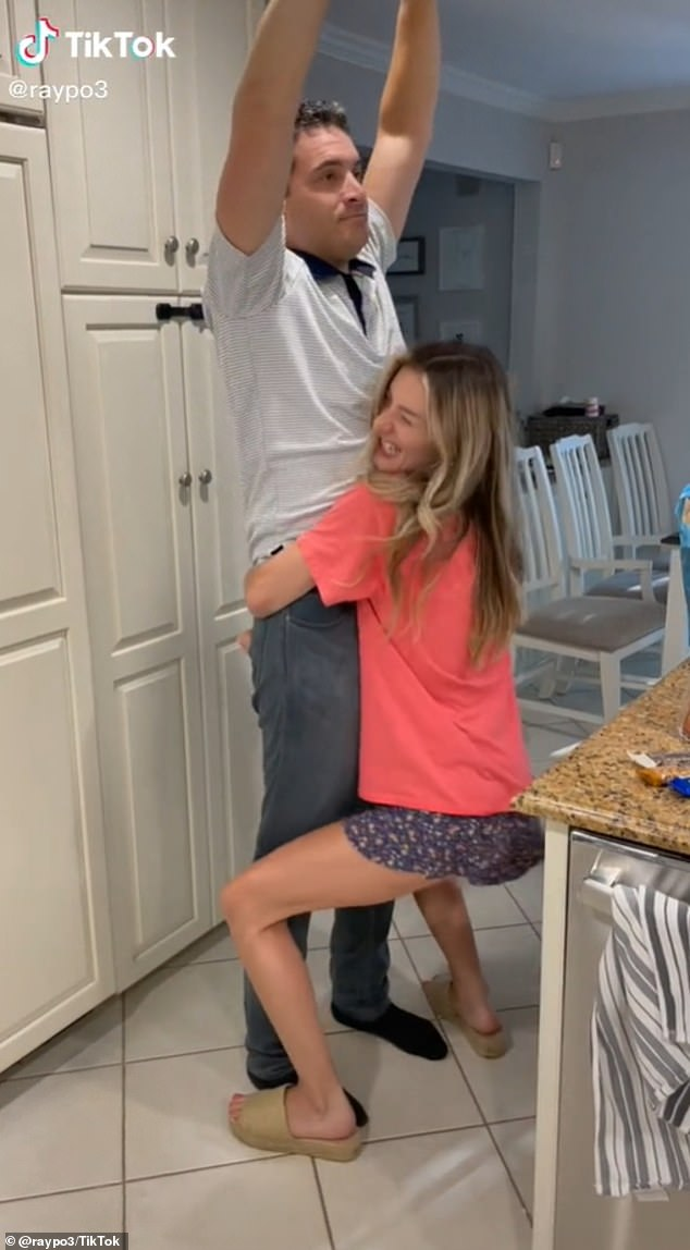 Grab hold! In the clip, Andrew and his children's nanny Lizzie Norton take turns lifting each other up