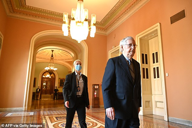 """Senate Minority Leader Mitch McConnell welcomed the infrastructure vote but quickly moved to condemn the next phase of Democrats spending plans.'The policies they want to put behind this budget resolution read like somebody walked across the rotunda to the House and handed """"the Squad"""" a pen and a piece of paper,' he said."""