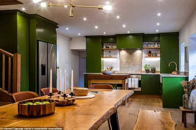 The tumbledown wreck of a barn was unrecognisable after the renovation, with handmade bookcases lining the walls and a green kitchen (pictured)