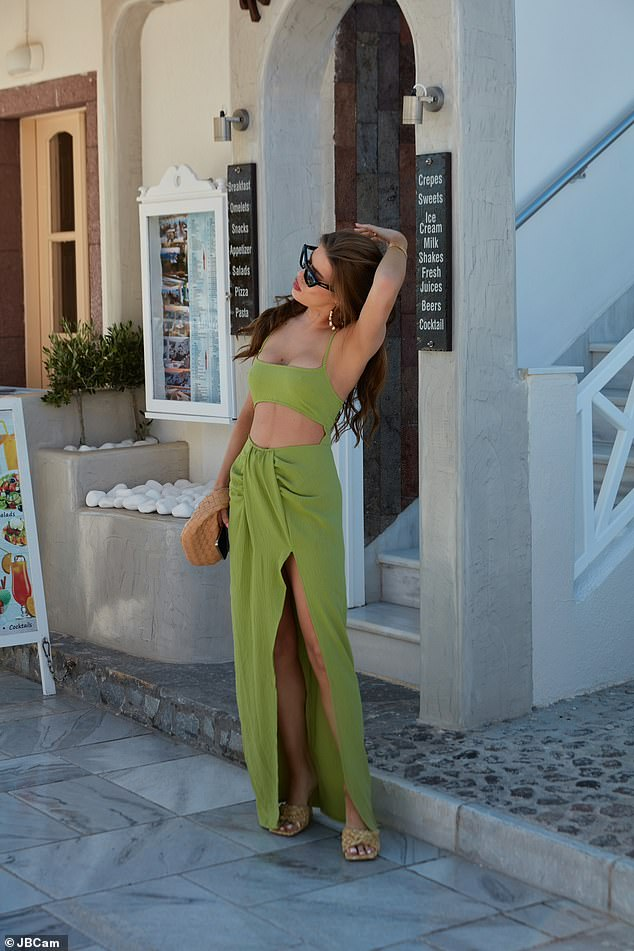 Wow: All eyes were certainly on Tamara Francesconi on Thursday as she wowed in a sexy green cut-out dress by PrettyLittleThing as she strolled through the streets of Santorini amid her working holiday
