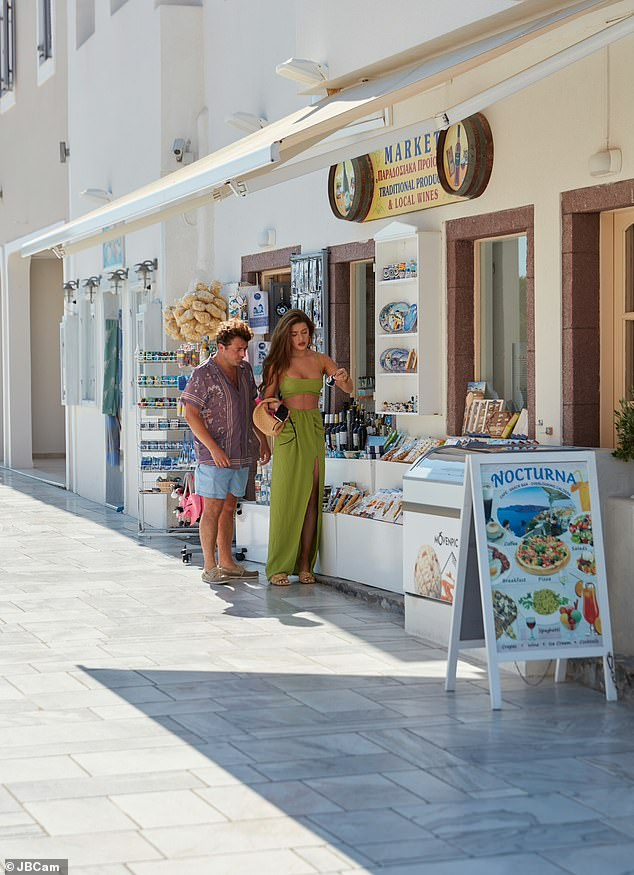 Out and about: Tamara appeared in good spirits as she strolled through the pretty streets with a pal, before making their way to the Andronis Luxury Suites
