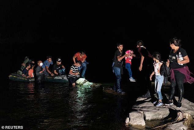 Migrants arrive each day along the U.S.-Mexico border. Here migrant families disembarks an inflatable raft after crossing the Rio Grande River overnight