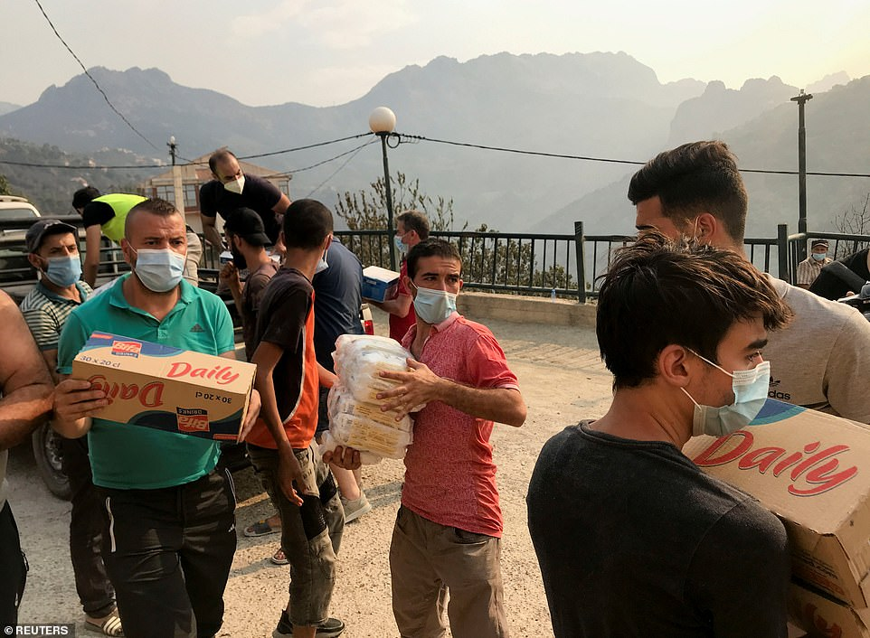 Volunteers unloaded humanitarian aid to people affected by the wildfires in Ait Daoud village, in the region of Kabylie in Algeria