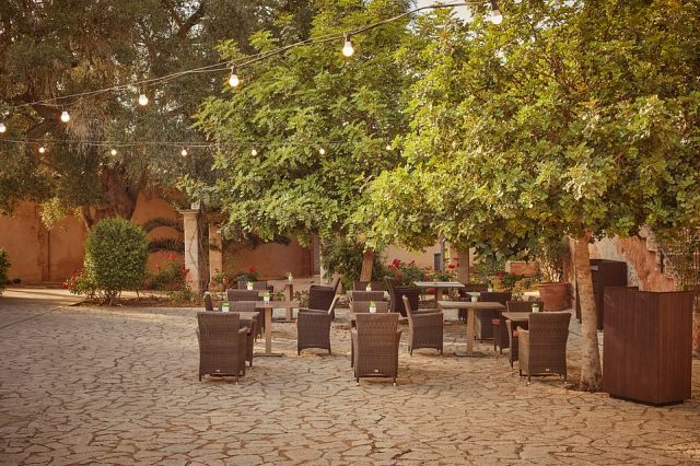 Ted's favourite area in the hotel grounds was the cobbled courtyard (pictured), where breakfast and evening dinner was served by the hotel's 'smashing staff'