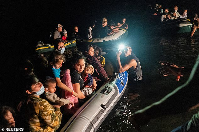 Mayorkas said that Homeland Security would look into new policies after the unprecedented July surge (pictured: Asylum-seeking migrant families arriving in the US on August 12th)