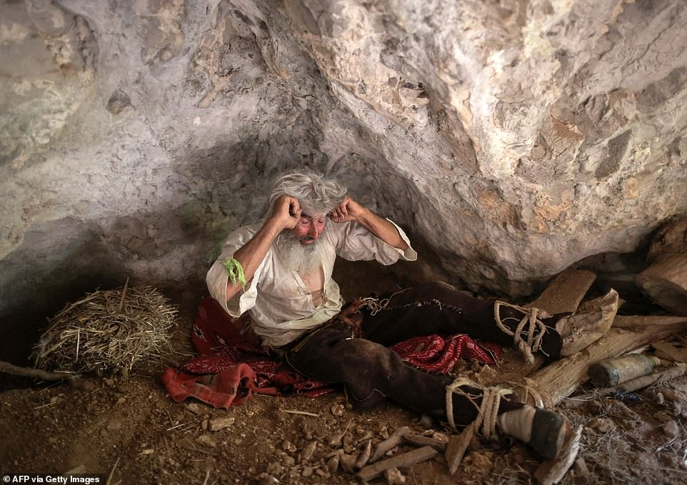Serbian hermit 70-year-old Panta Petrovic rests in his bedroom in his caveon the forested Stara Planina mountain in southern Serbia
