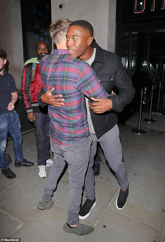 Bromance: The two of them hugged as they reunited before heading into the restaurant