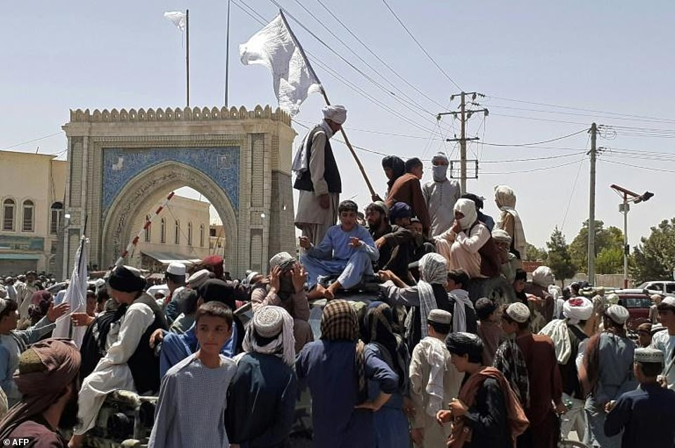 The Taliban standing on a roadside in Kandahar after taking over more parts of Afghanistan. The scale and speed of the Taliban advance has shocked Afghans and the US-led alliance that poured billions into the country