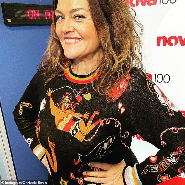 Smile! Chrissie posed in this outfit at Nova studios in July, drawing attention to her weight loss