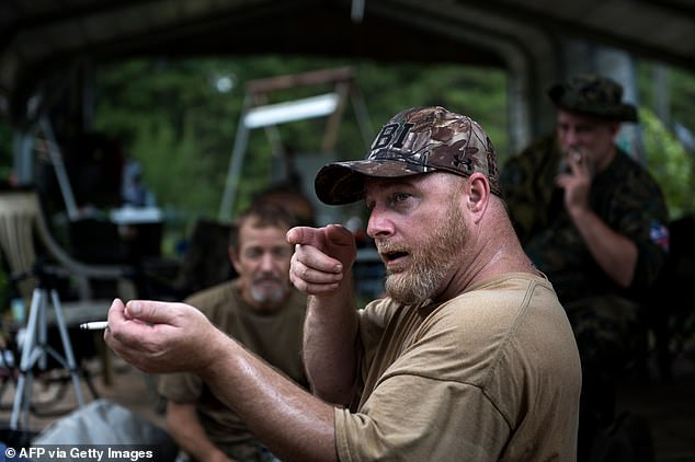 Donnie Hyatt, whose home was raided by the FBI on August 10, said that he knows far-right organizer Chris Hill (pictured) personally, and that Hill and his wife are frequently in communication. However, he maintains that they are not a member of the militia: 'I don't participate for this very reason - I can't have my life destroyed'