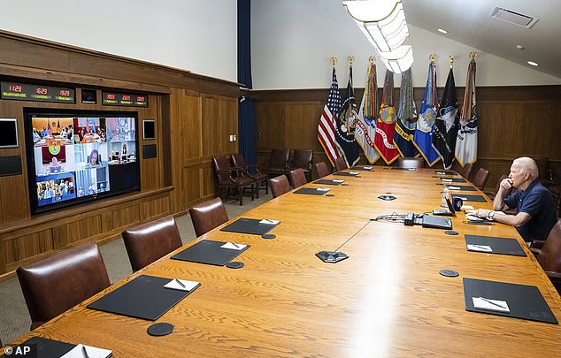 President Joe Biden meets virtually with national security advisers from Camp David where he's currently on August vacation