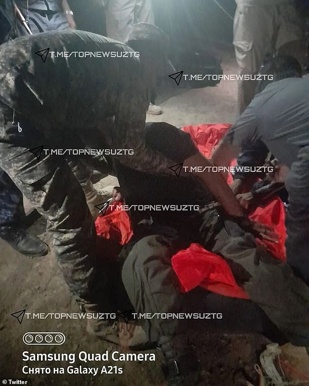 This image appears to show another pilot of the aircraft being helped after he crashed