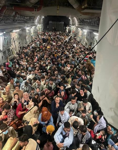 Overloaded but Wheels Up: Photo Shows 640 Afghans on a US Cargo Jet Designed to Carry 150 After They Ran on Before Soldiers Could Close Ramp and Hero Pilot Still Took Off From Kabul and Saved Them All