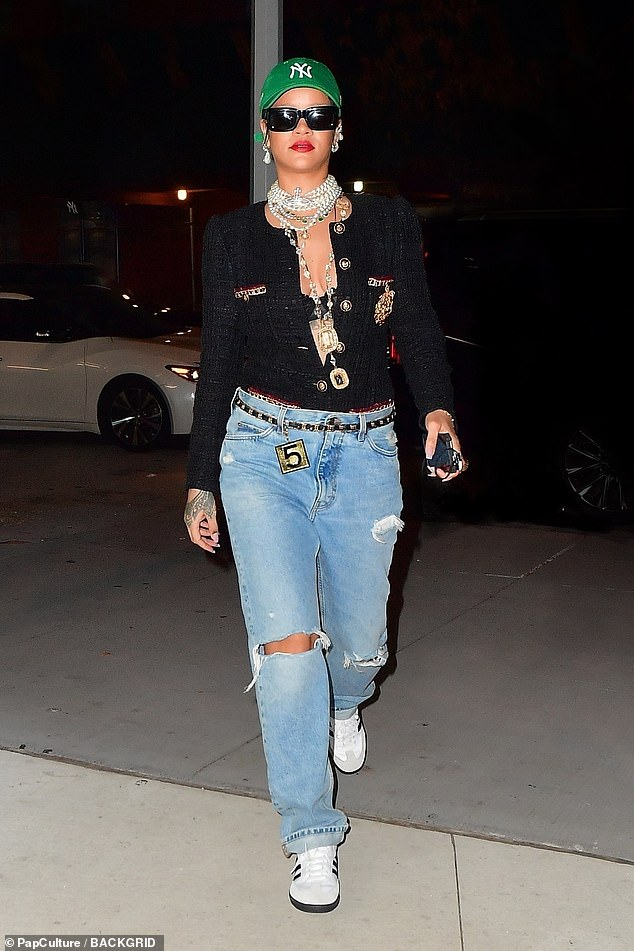 Stylish star: The singer looked runway ready while running errands late at night, surrounded by her entourage
