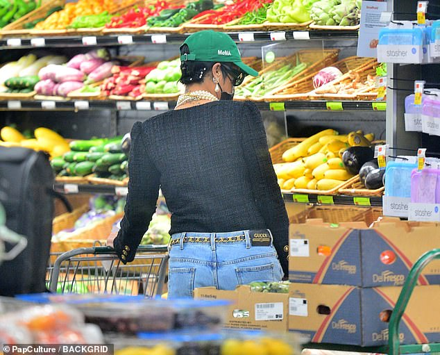What's on offer?The hitmaker flashed her bra in a plunging black cardigan which she teamed with ripped Gucci jeans as she eyed up some of the eggplants on sale