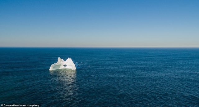 ICEBERG OFF THE COAST OF NEWFOUNDLAND, CANADA: 'Every year, large icebergs calve from the glaciers of the Canadian Arctic and Greenland, then float southward into the Atlantic Ocean, finally melting off the coast of Newfoundland and Labrador,' Martin reveals. 'Along the coast of Newfoundland, icebergs are best viewed in late May and early June. Off Labrador, they can be seen between March and July. As climate change accelerates, larger icebergs pass the region in greater numbers'
