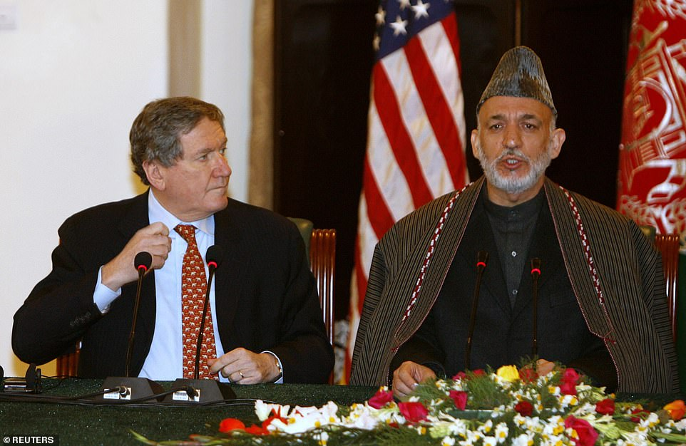 According to Holbrooke's diary which was turned over to his biographer after his death, Biden was staunchly in favor of pulling out of Afghanistan even 11 years ago (Pictured: Holbooke with former Afghan president Hamid Karzai in 2009)