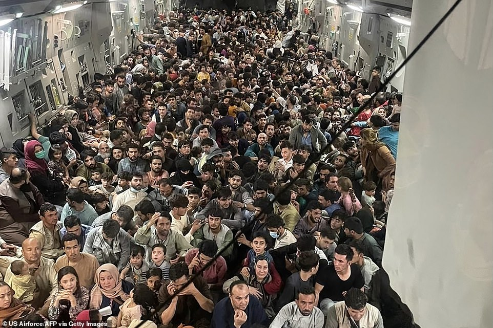 Refugees cram inside a U.S. Air Force C-17 Globemaster III flown from Kabul to Qatar on Sunday. The plane safely evacuated some 640 Afghans from Kabul late Sunday