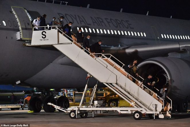 British nationals and Afghan evacuees are seen disembarking an RAF Voyager A330 aircraft at Brize Norton last night