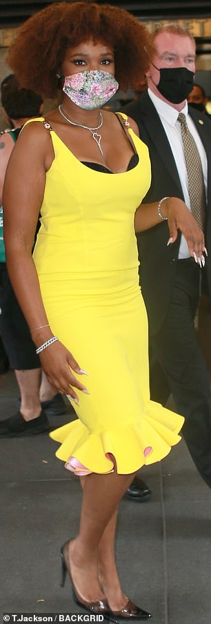 She looked fabulous: she was still dressed in her glamorous TV ensemble, including a deep canary-yellow cocktail dress with a ruffled hem