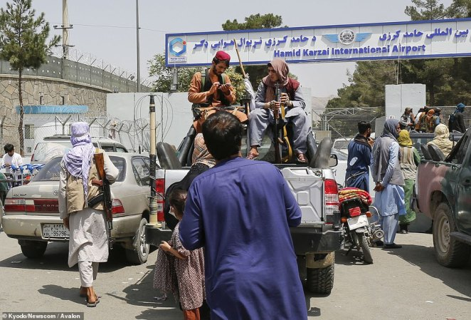 Taliban soldiers at the entrance of Afghanistan's international airport in Kabul. UK military chiefs admit that the new regime now has total control of access to the airport