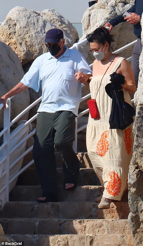 Something to tell? Robert De Niro was seen putting on a cosy display with a mystery woman as they enjoyed a day out on the coast of Côte d'Azur, France on his 78th birthday on Tuesday