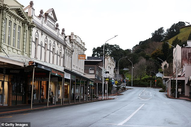 Kiwis were put into an intense level four lockdown on Tuesday after the country's first community case in six months, with at total of 10 cases now linked to the cluster. Seen here is a deserted street in Devonport on Wednesday