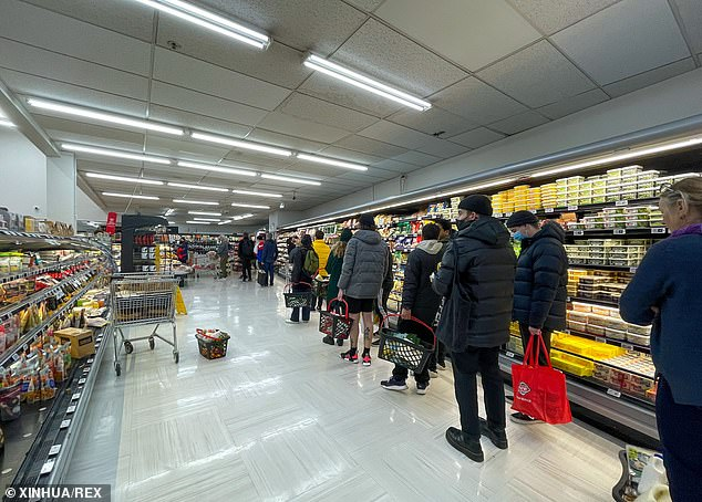 The latest lockdown came into effect at midnight on Wednesday, sparking panic buying in New Zealand supermarkets, as seen here in Wellington