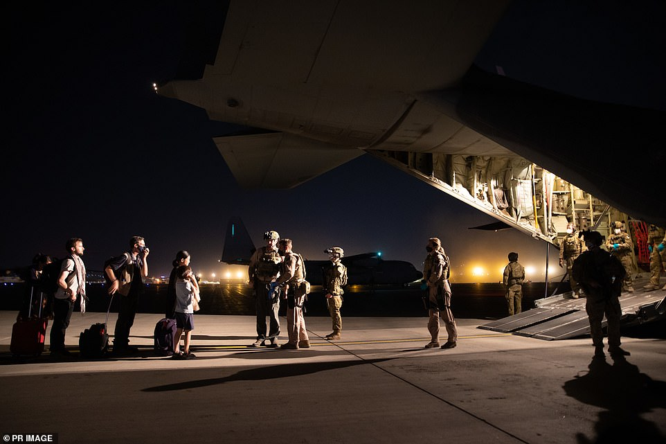 Evacuation flights continued throughout the night Tuesday and into Wednesday, with Australian troops escorting citizens and visa holders on to aircraft in the earlier hours