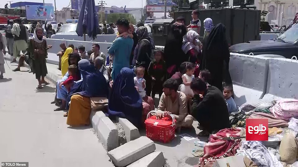 While thousands of people have arrived at Kabul airport trying to get on flights out of the country (pictured), some western visa holders on the ground have said they are in hiding nearby for fear Taliban gunmen will target them