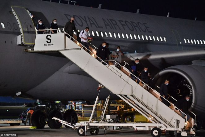 Afghans allowed to come to the UK will be distributed across the country. Pictured: British nationals and Afghan evacuees arrive on a flight from Afghanistan at RAF Brize Norton, Oxfordshire