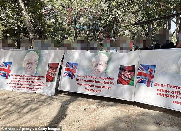 Former British interpreters protesting in Kabul on August 13 before the capital was overrun by the Taliban. Their faces are obscured for security reasons