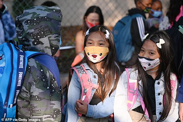 Students returned to school wearing masks on Aug. 16. Pictured, students at Grant Elementary