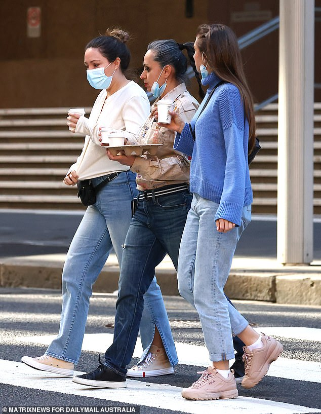 Covid-ravaged New South Wales is on track to start racking up over 2,000 cases a day, as the Delta variant's reproductive rate skyrockets (pictured, Sydneysiders in lockdown on Wednesday)